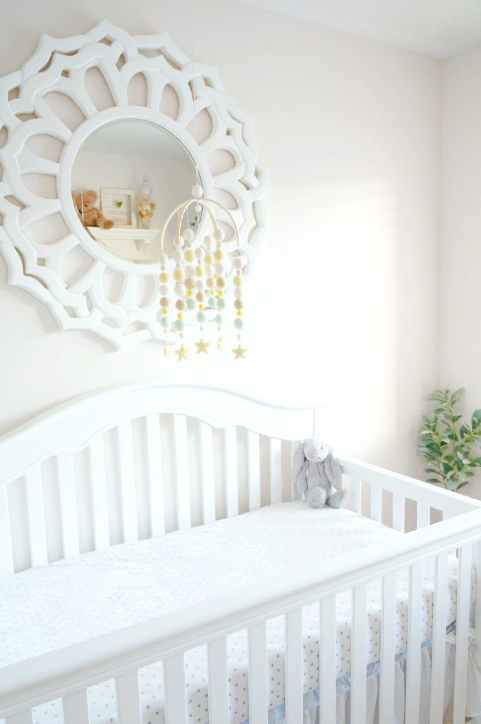 A beautiful white crib from Wayfair in a gender neutral baby nursery