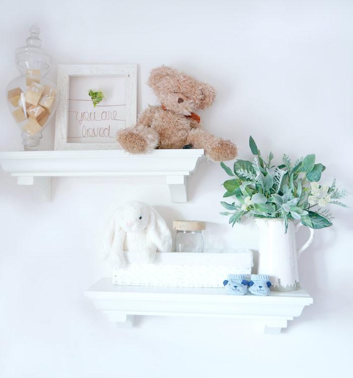 White floating shelves from pottery barn for gender neutral baby nursery