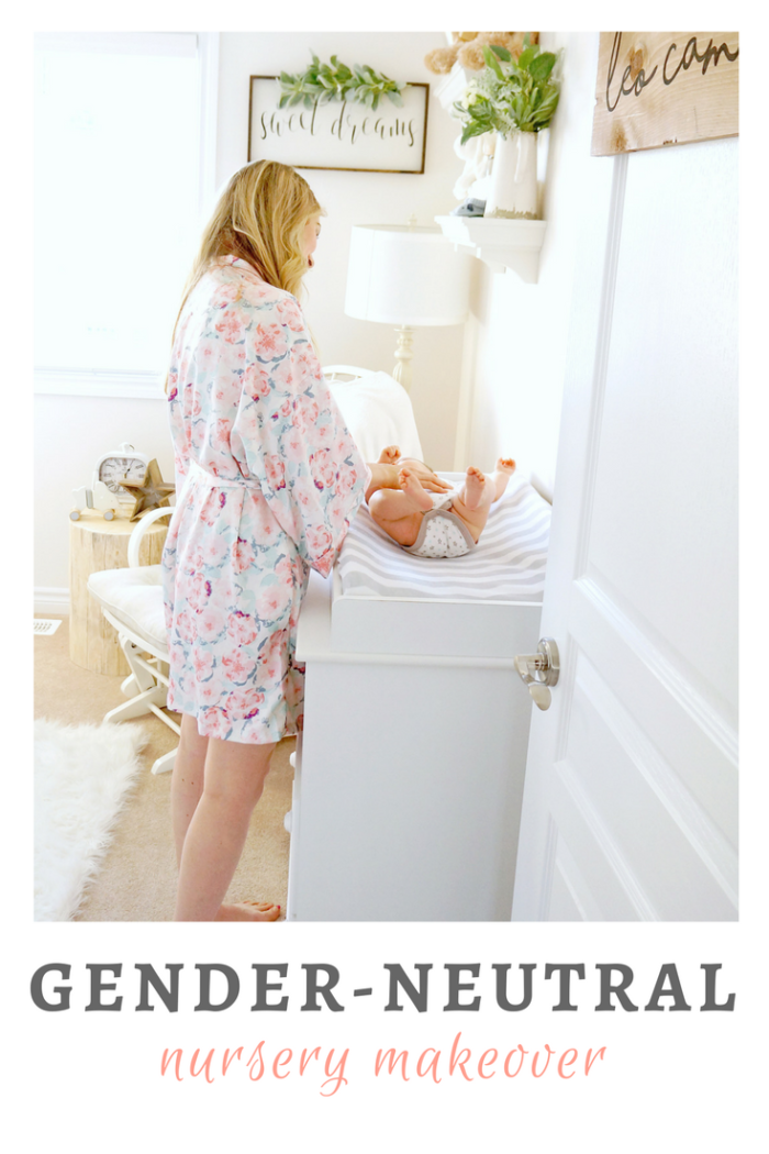 A loving mother playing with her baby in gender neutral baby nursery