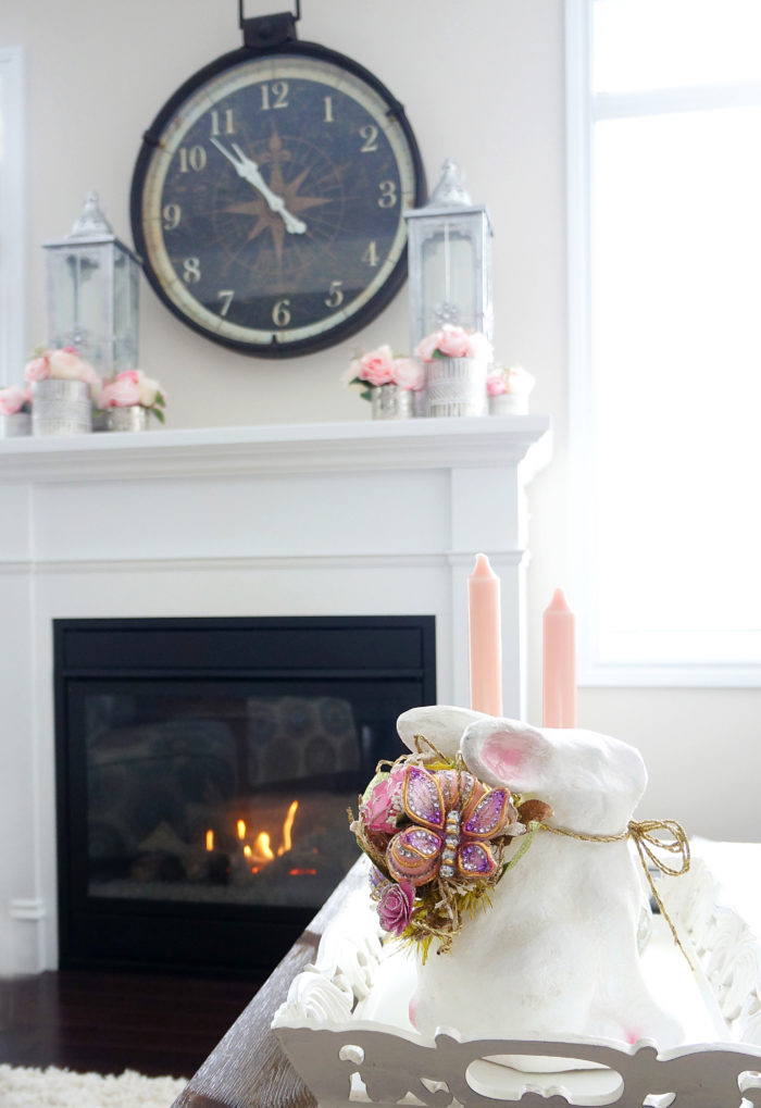 Pretty Easter bunny and pink flowers on fireplace mantel for Spring living room decoration