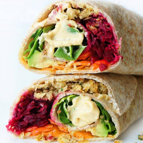 vegan falafel wrap stacked on top of each other