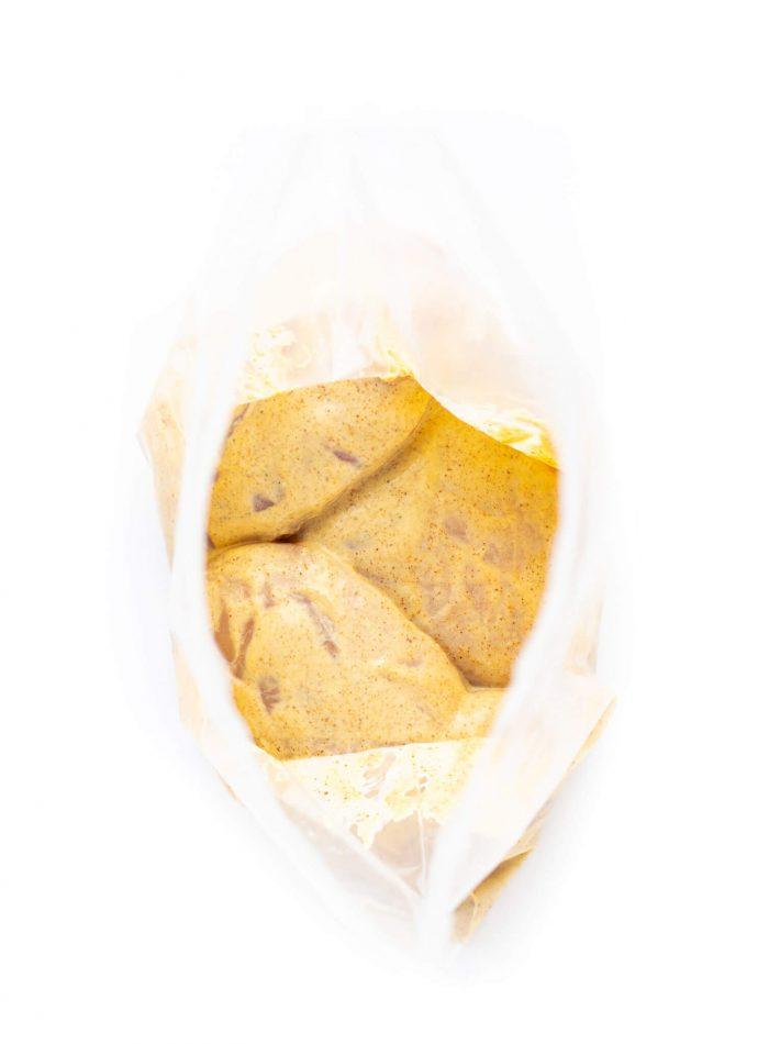 Curried yogurt chicken marinade in ziplock bag