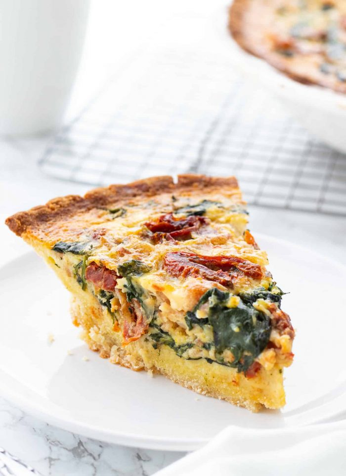 slice of spinach bacon quiche