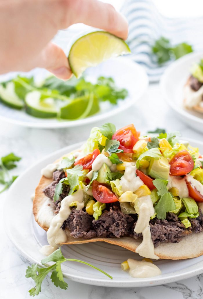 Vegan Black Bean Tostadas with squeeze of lime