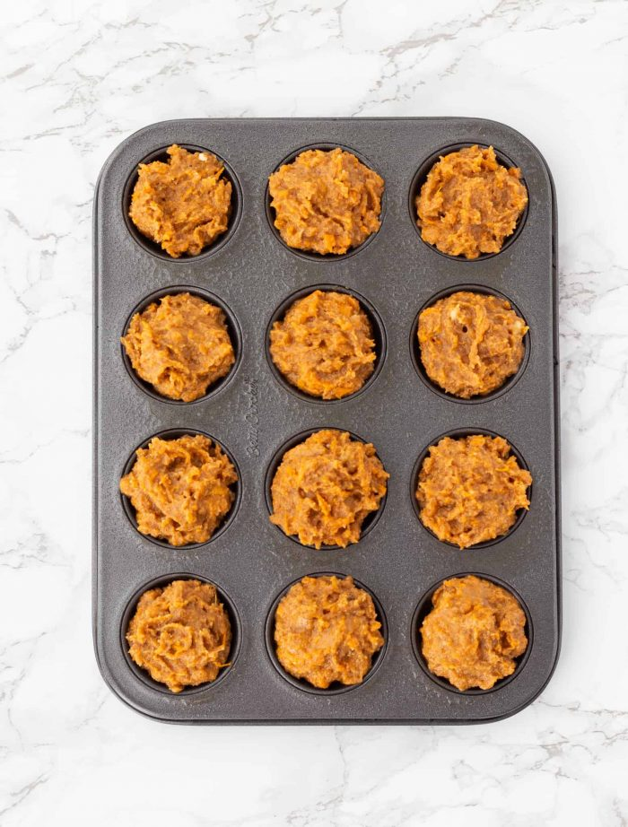 unbaked muffins in muffin tin