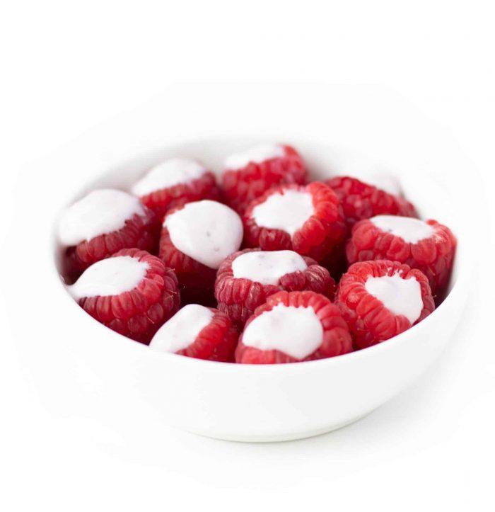 yogurt filled raspberries in a bowl