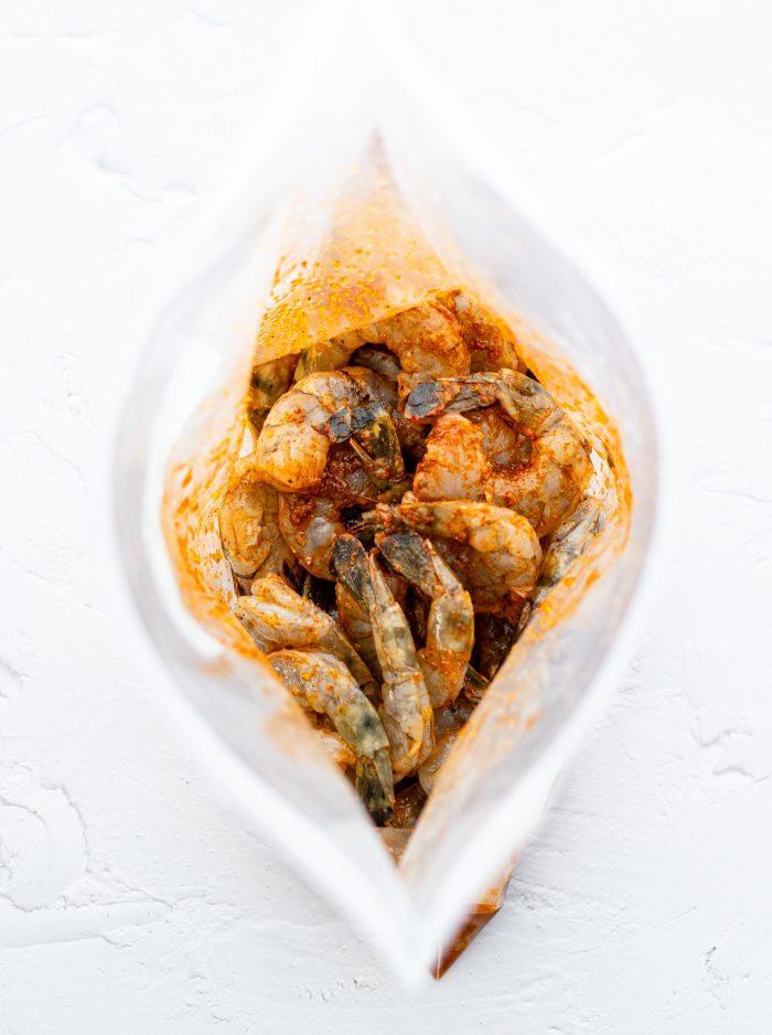 raw shrimp marinating in a ziploc bag