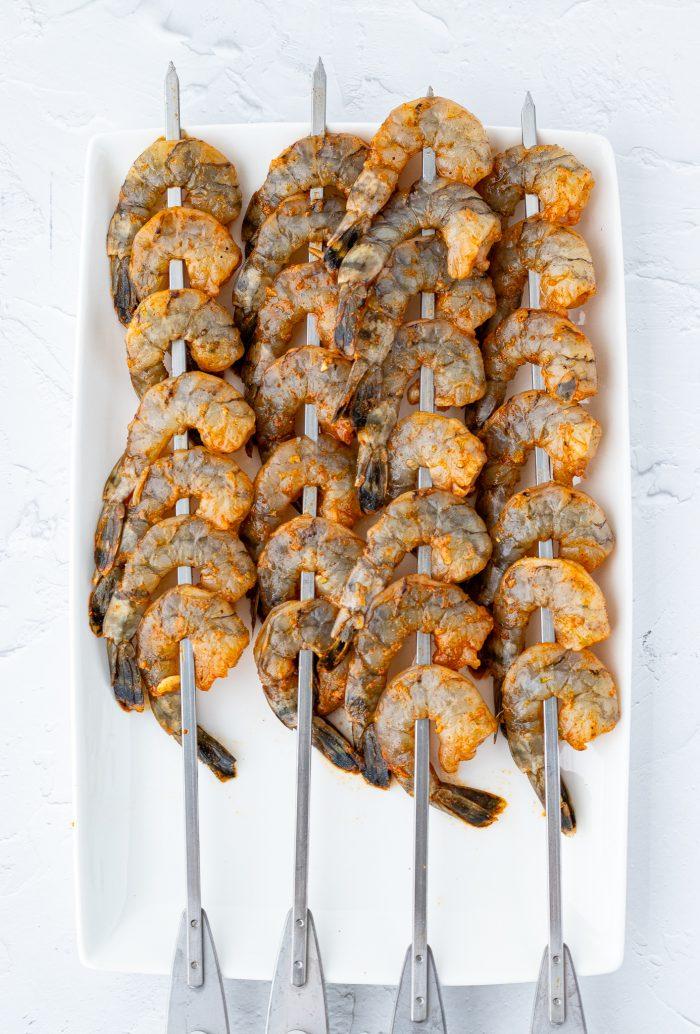 raw shrimp on skewers