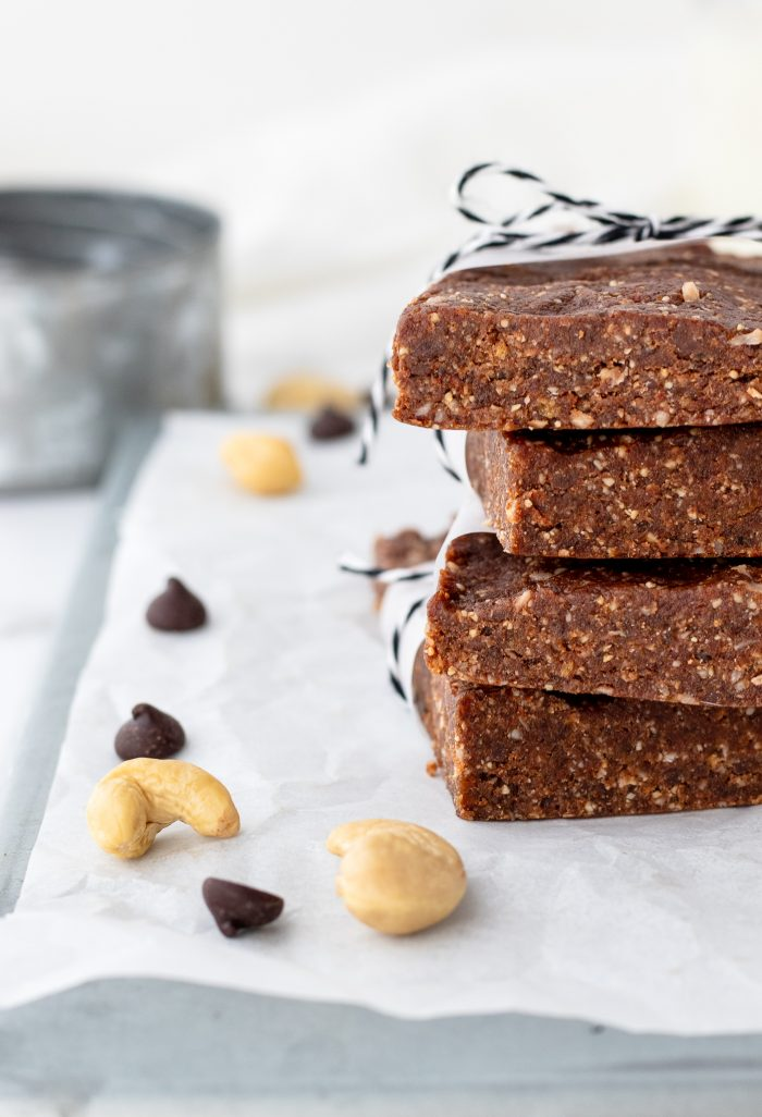 Stack of homemade larabars with nuts and chocolate