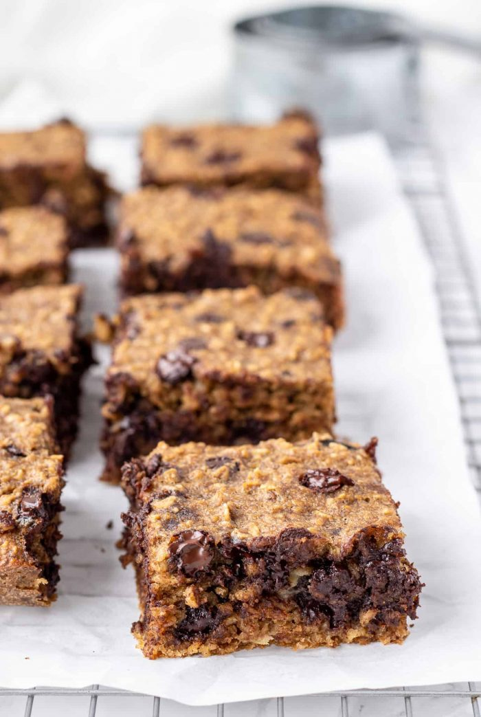 Breakfast bars cut into squares on a cooling rack lined with parchment paper