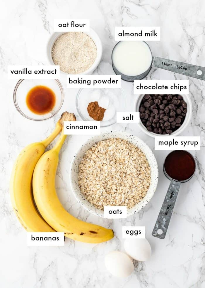 ingredients for oatmeal breakfast bars on a marble background with labels