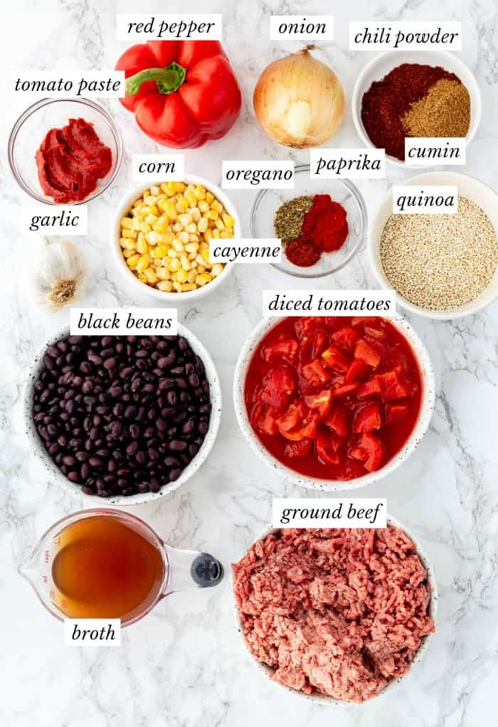 ingredients for chili on marble background with labels
