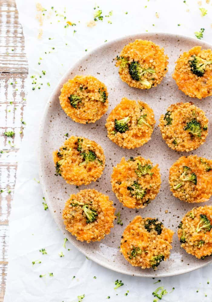 broccoli cheddar quinoa bites on large speckled plate