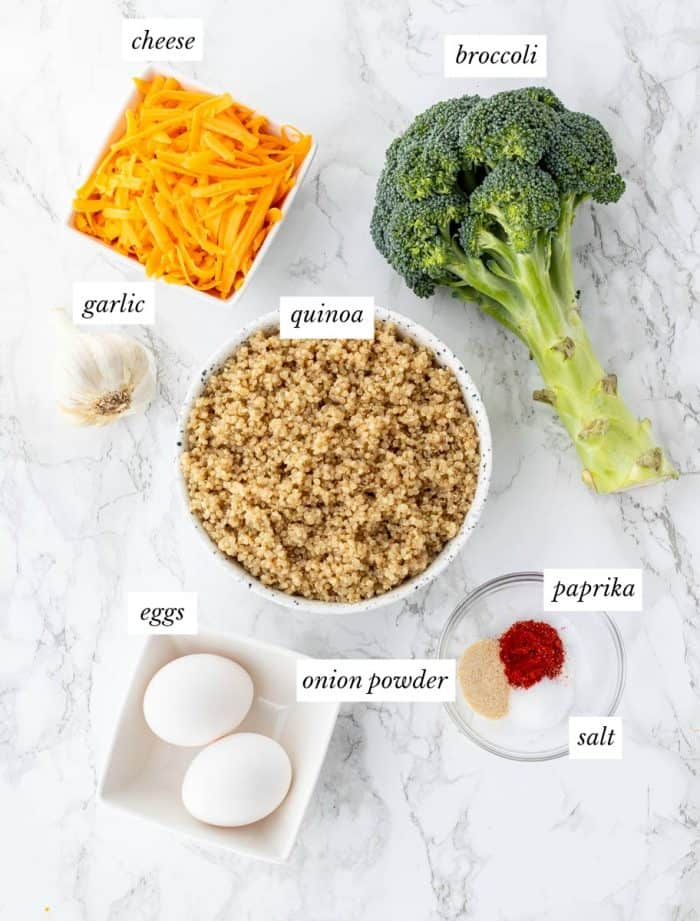 ingredients required for quinoa bites with labels on a marble background