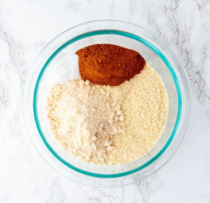 dry ingredients for muffins in a glass bowl on a marble background
