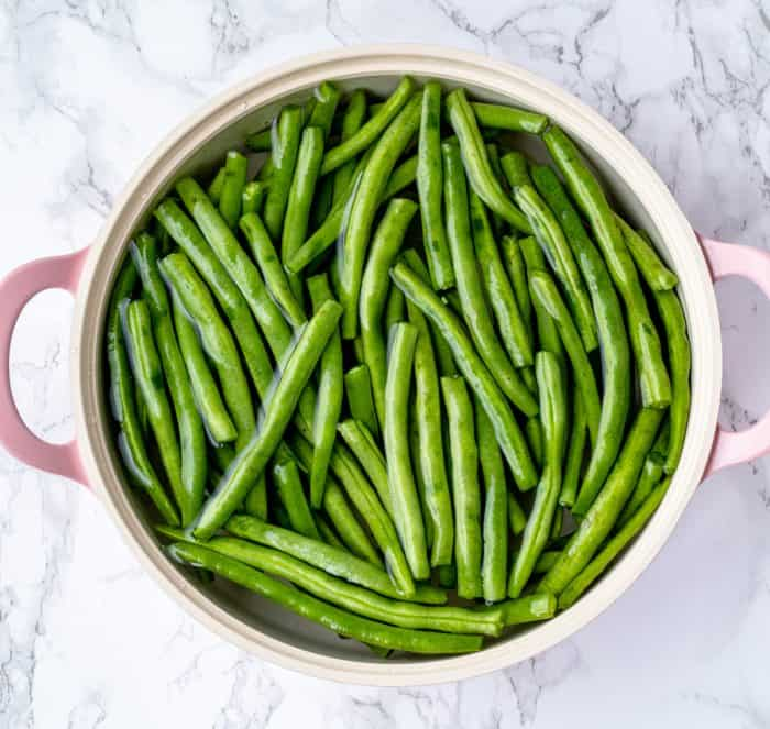 green beans cooking in a large sauce pan