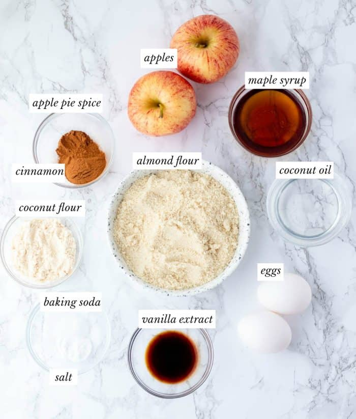 ingredients for apple muffins with labels on marble background