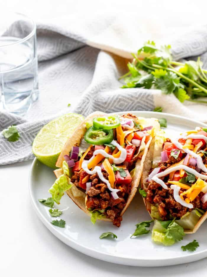 Crock Pot Taco Meat Pot taco meat in tortillas and topped with jalapenos and sour cream/