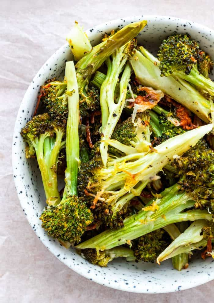 A bowl of roasted broccoli ready to serve.