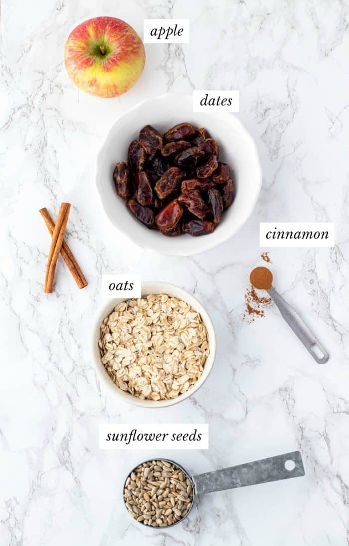 Ingredients for energy balls with labels on marble background