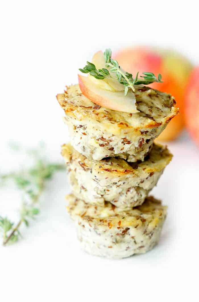 stack of turkey muffins with apple slices and thyme on top
