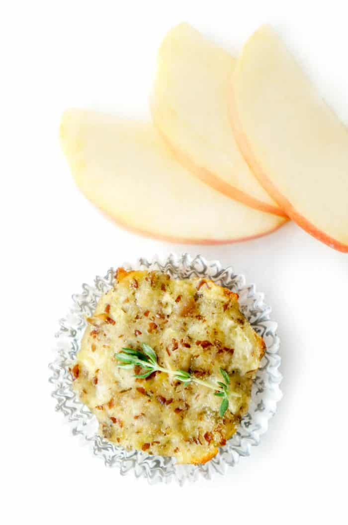 Top down shot of mini turkey muffin with thyme and apple slices