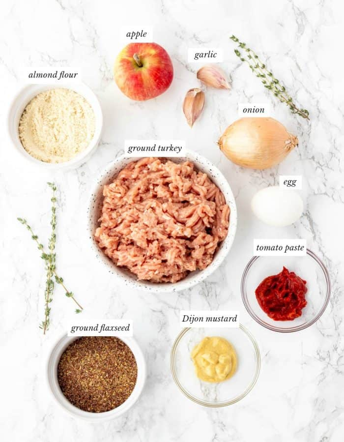 ingredients for turkey meatloaf muffins with labels on marble background