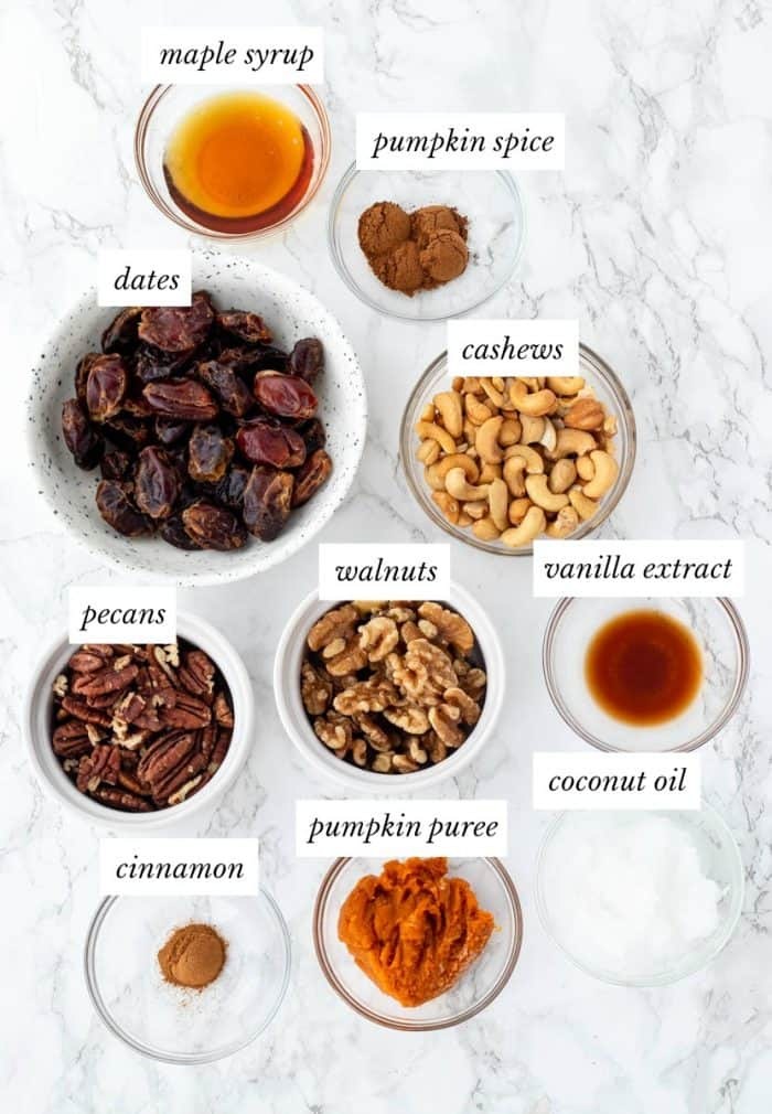 ingredients required for no bake pumpkin cheesecake on marble background with labels
