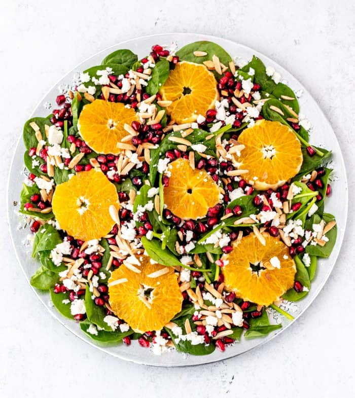 Overhead shot of te salad on a white plate ready to serve.