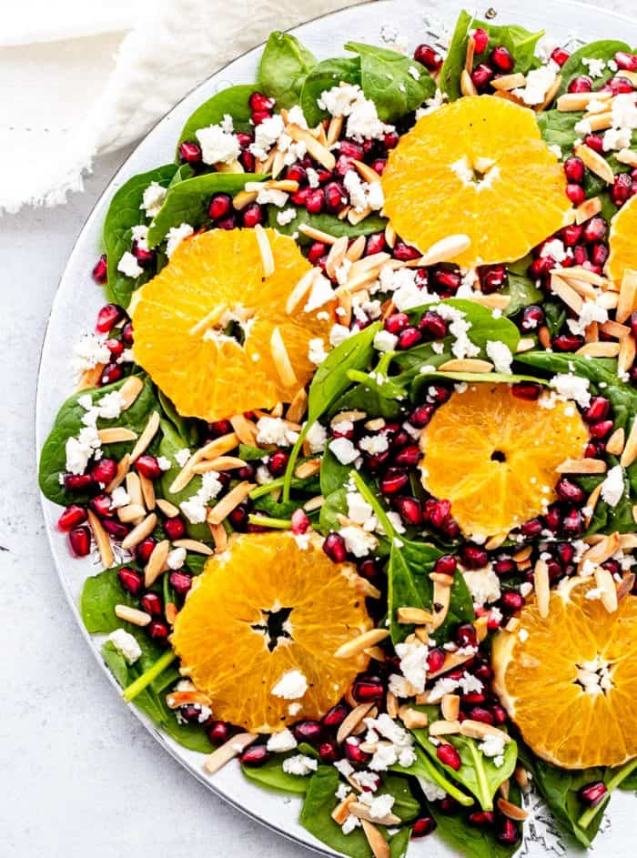 Overhead shot of the salad with five rounds of fresh orange placed on top.