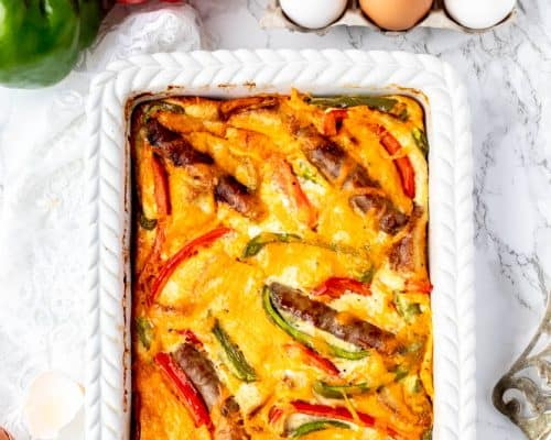 The baked egg casserole in a white baking dish.