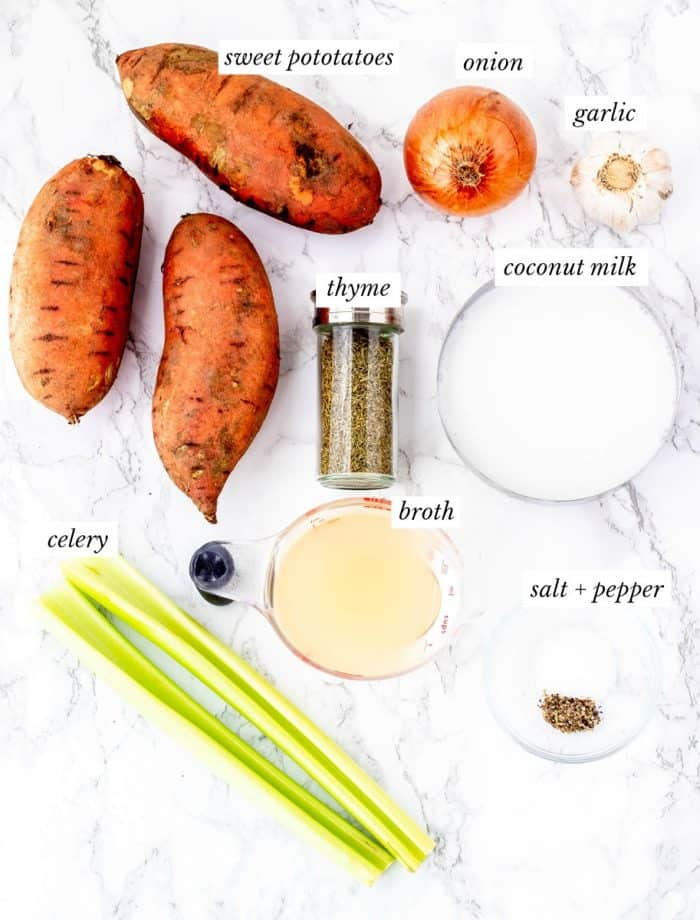Ingredients for sweet potato soup with labels on marble background