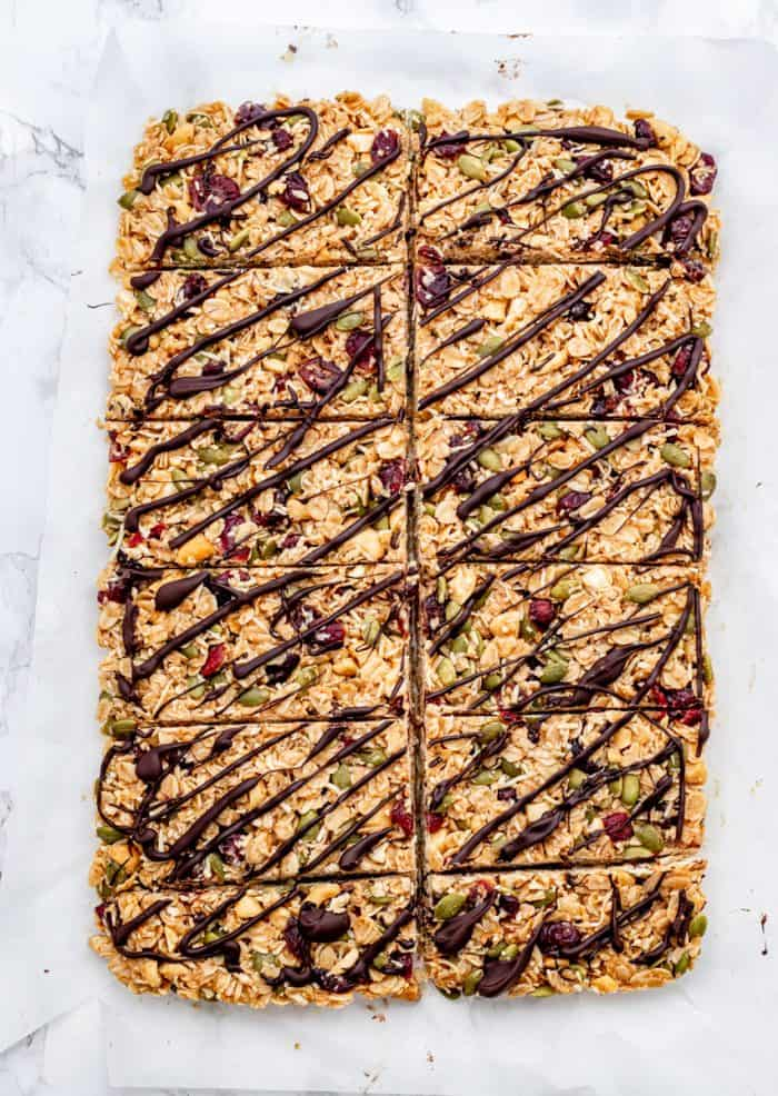 granola bars cut into pieces on a piece of parchment paper