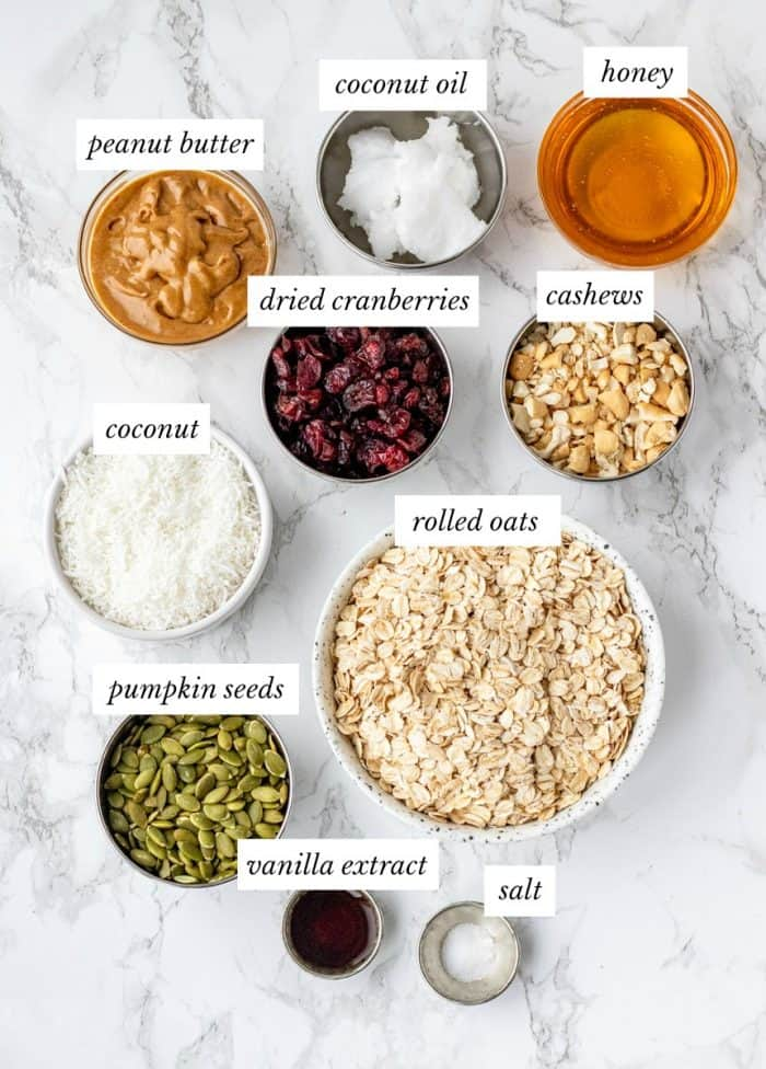 ingredients for granola bars with labels on marble background