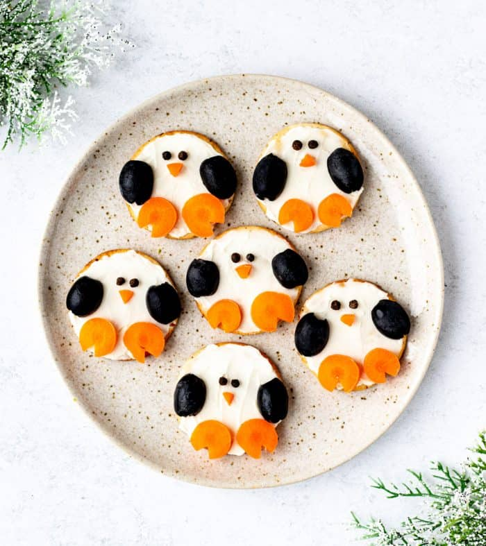 penguin crackers on a plate with greenery