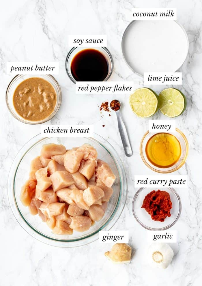 ingredients for Thai peanut chicken with labels on marble background