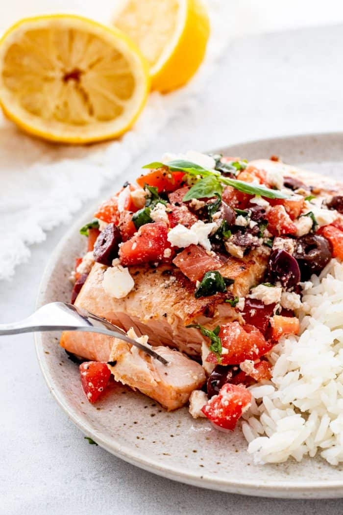Mediterranean salmon served in a plate with rice.