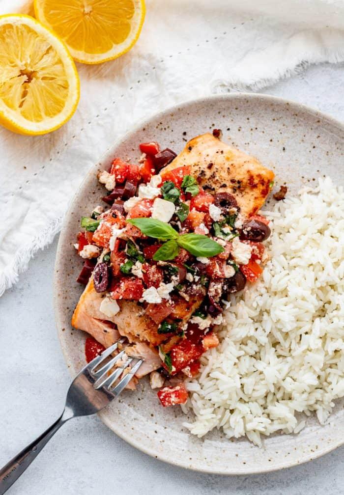 Mediterranean salmon being eaten with a fork.