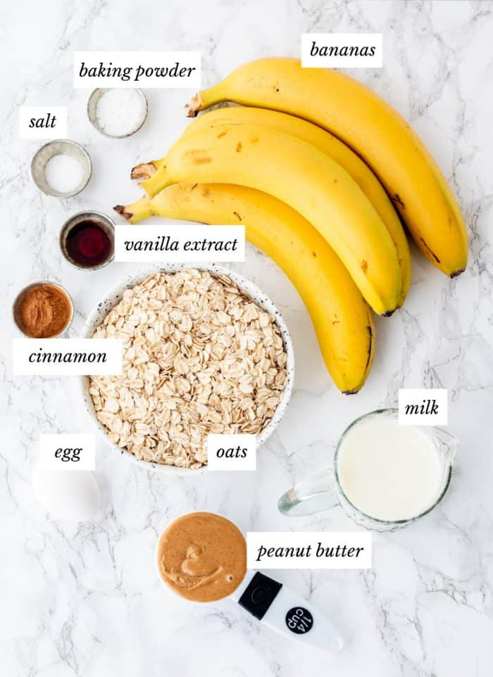 ingredients required for the baked oatmeal on marble background with labels