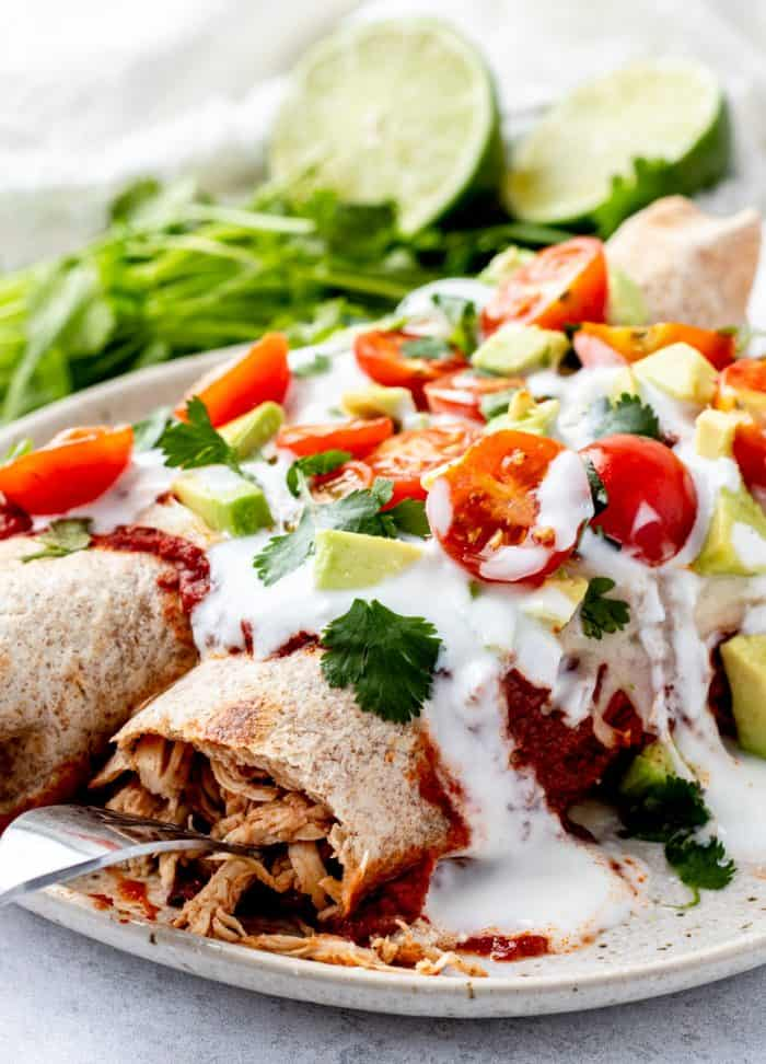 Close up of the toppings on the chicken enchiladas.