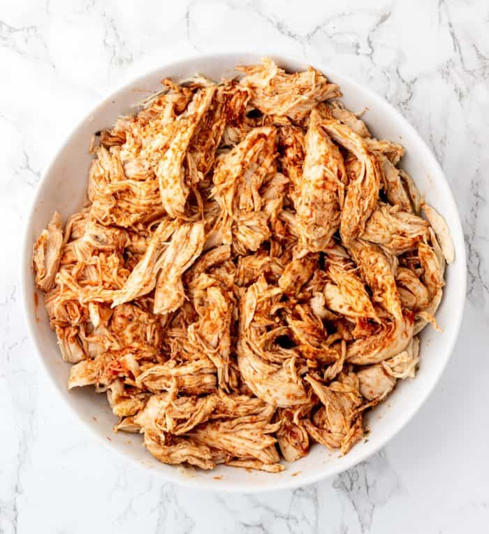 Shredded chicken in a bowl.