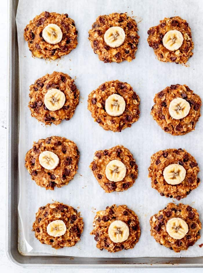 The baked healthy banana cookies on a baking sheet.