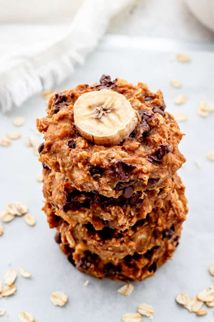 Four healthy banana cookie stacked on top of each other.