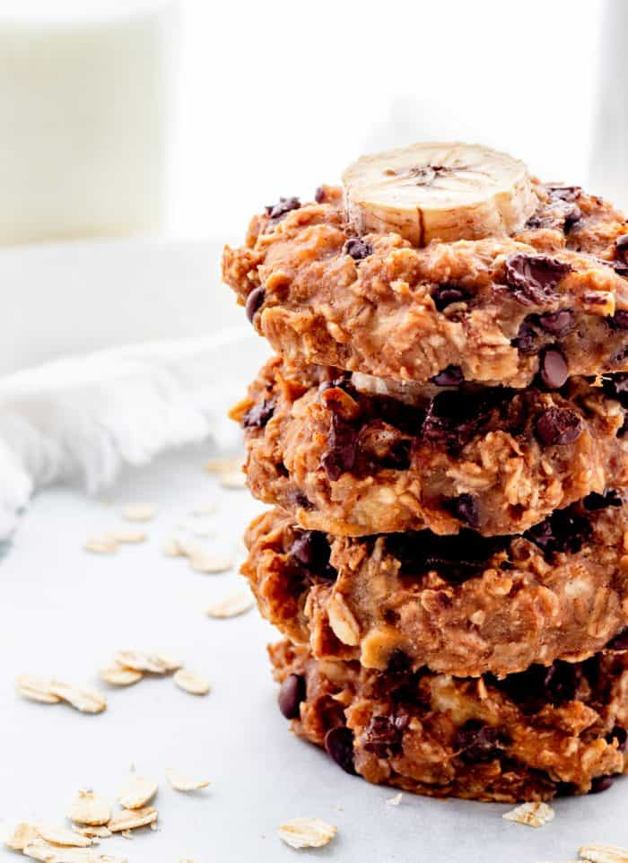 Four banana cookies stacked on top of each other ready to eat.