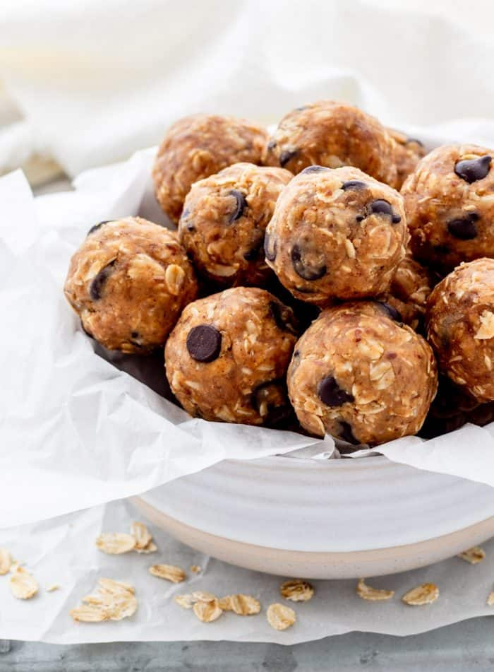 Bowl of energy balls surrounded by oats