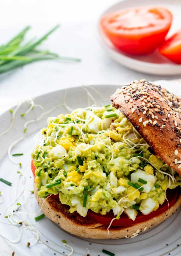 Avocado egg salad on an open bagel.