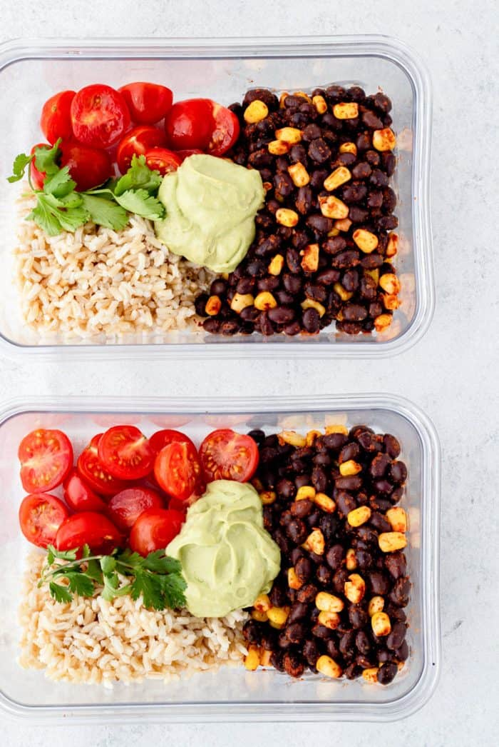 Black bean burrito bowls in two meal prep containers.