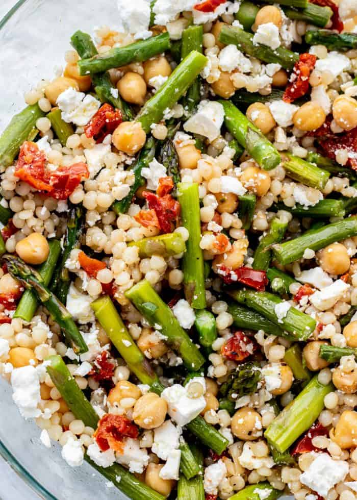 up close shot of pearl couscous salad with roasted asparagus and chickpeas