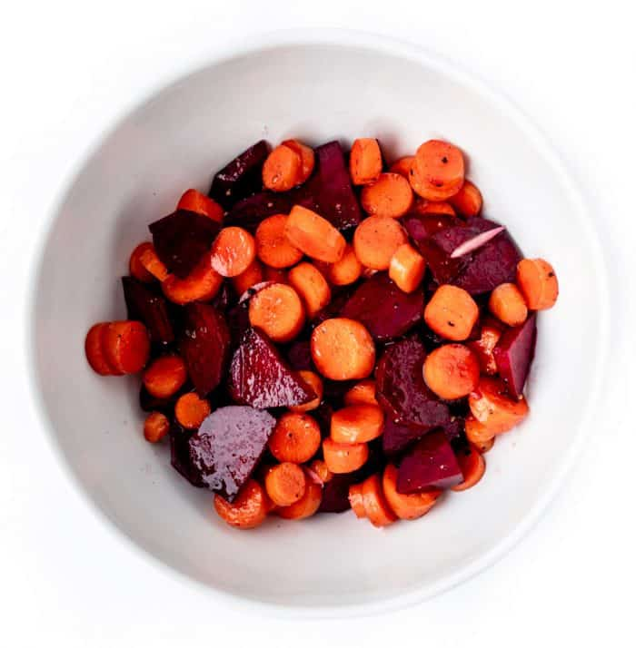 Carrots and beets in a white bowl.