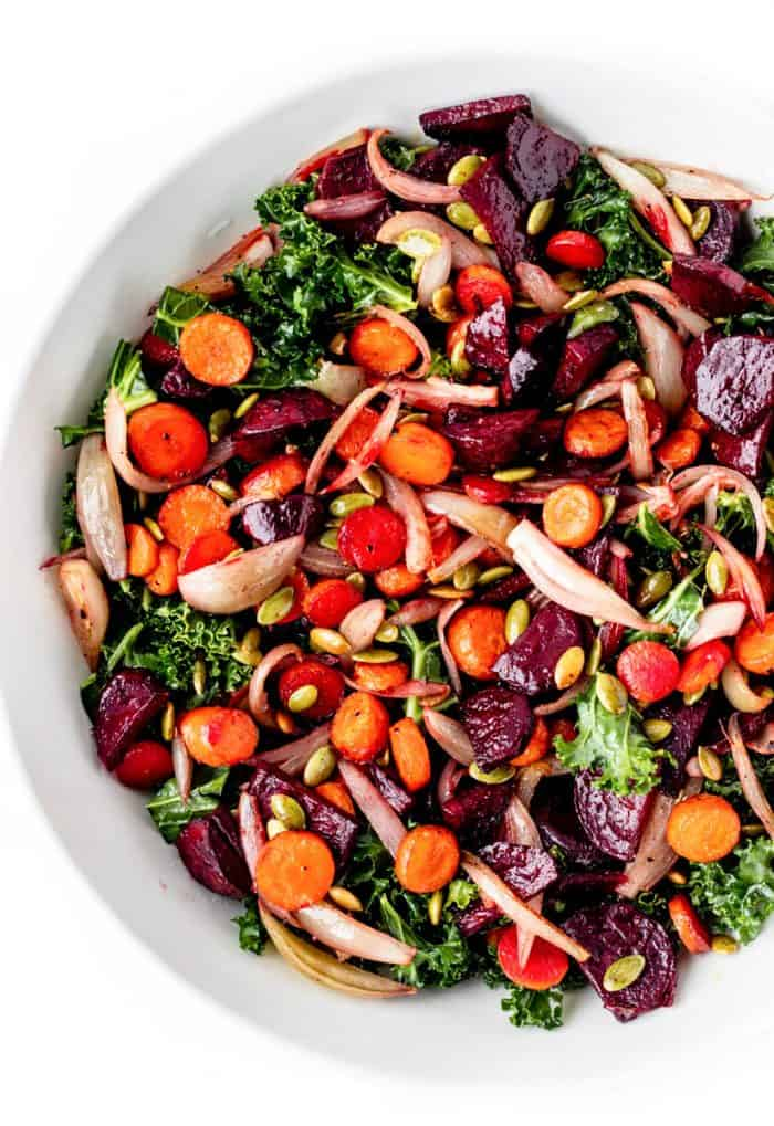 Overhead shot of kale salad in a large white bowl